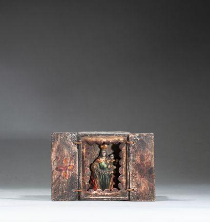 Retable présentant la vierge de Cuzco tenant...