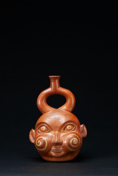 Magnifique vase portrait présentant la tête...
