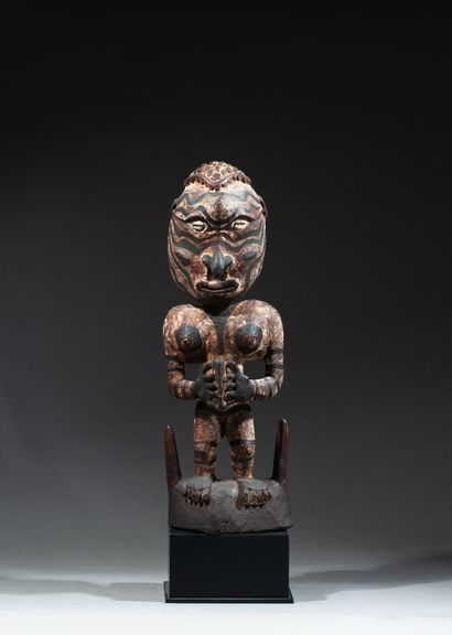 Ancestral figure resting on a two-pointed...