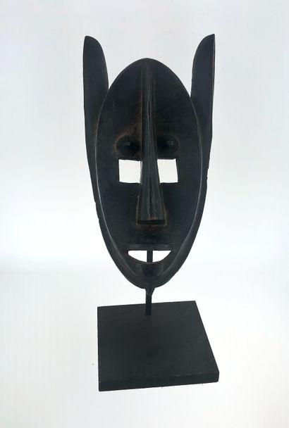 Beau masque anthropo-zoomorphe de la société...