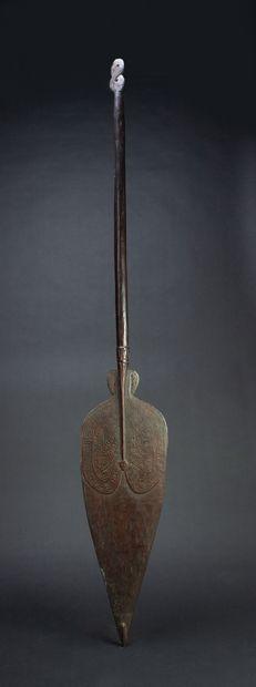 Paddle with engraved decoration of symbolic...