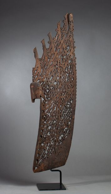 A rectangular canoe prow element, it is decorated...