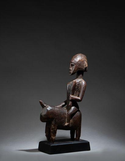 Statuette présentant un cavalier se tenant...