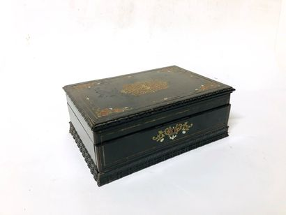 Blackened wooden box opening on the front...