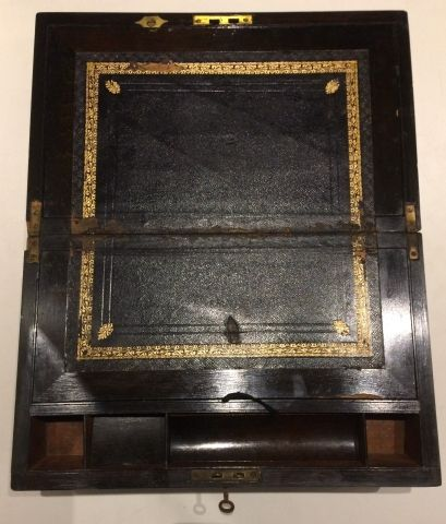 Wooden and brass box forming a travel writing case in black morocco, the lid with...