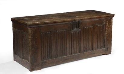 Oak chest with carved decoration on the front...