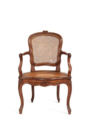 Armchair with convertible caned backrest...