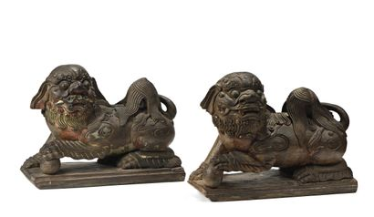 CHINA  Pair of carved wooden seal dogs lying on a rectangular base, the left front...