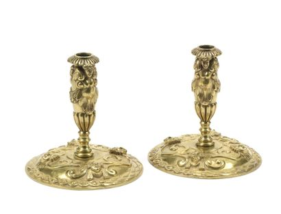 Pair of chased and gilded bronze candleholders...