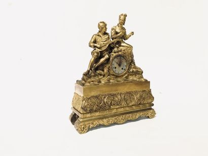 Clock in chiselled gilt bronze, the movement...