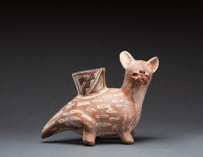Vase  modelé d'un félidé tenant sa proie...