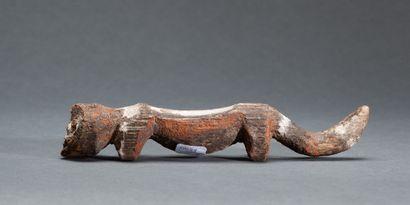 Figurine « Kiké »  présentant un homme-chien...