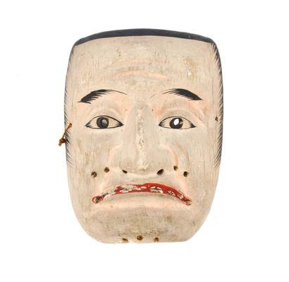 Masque de théâtre  sculpté d'un visage grimaçant...