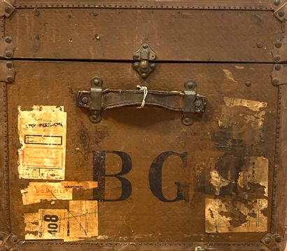 Two travel trunks, one in wood lined with imitation wickerwork and opening on two...