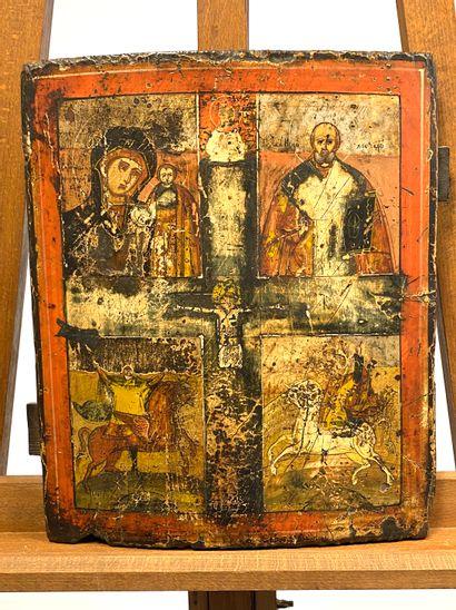 Icône figurant au centre la Crucifixion,...