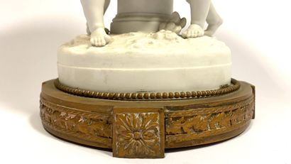 Element of especially of table in biscuit of porcelain mounted in bronze, representing...