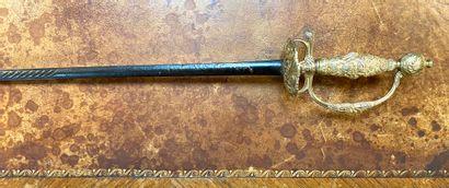 Epée de Cour. Monture en bronze ciselé et doré à décor rocaille. Garde à une branche,...