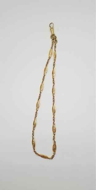 Chaîne de montre en or jaune 18k (750 millièmes)...
