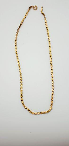 Collier en or jaune 18k (750 millièmes) formé...