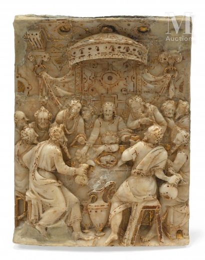 The Last Supper  Carved alabaster plaque with gold highlights fixed on an oak panel....