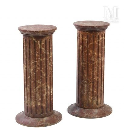 A pair of covered amphoras of ovoid shape on a pedestal in wood and stucco with...