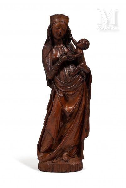 Vierge à l'Enfant tenant une grappe de raisins...