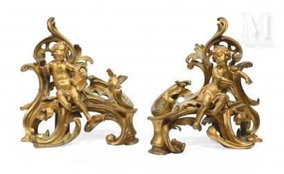 Paire de chenets en bronze ciselé et doré ornés des allégories de la sculpture et...