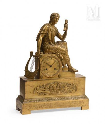 Pendule en bronze ciselé et doré à décor...