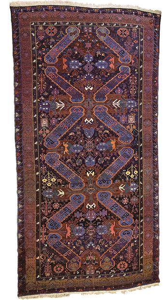 SEIKOUR  Important tapis à décor de deux...