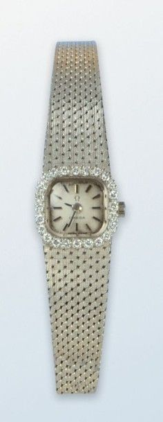 Bracelet montre pour dame en or gris 18 k,...