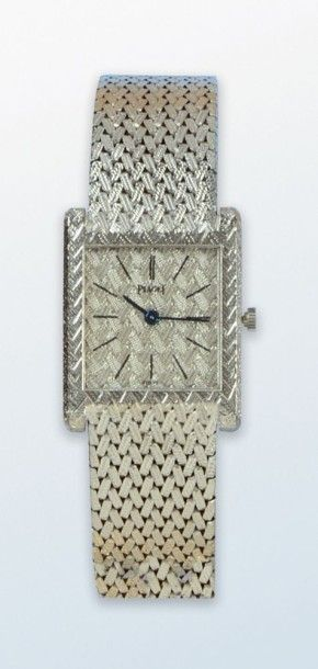 Bracelet montre en or gris 18 k de marque...