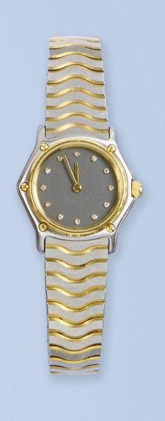 Bracelet montre de femme en acier et en or...