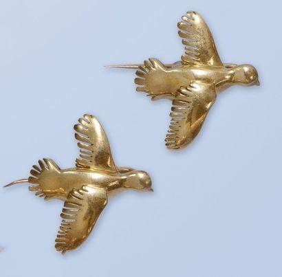 Paire de pin's en or jaune 18 K, 750 millièmes....