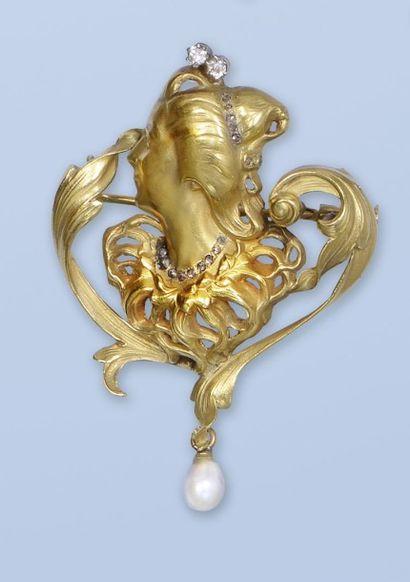 Pittoresque broche pendentif en or jaune 18, (750 millièmes). Elle représente le...