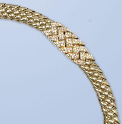 Bracelet souple formant un ruban,, en or...
