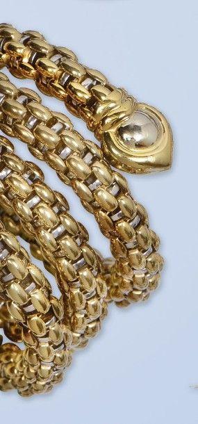 Bracelet flexible en or gris et or jaune...