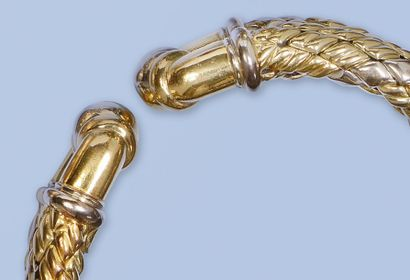 Bracelet flexible en Or gris et Or jaune 18 K, 750 millièmes. Il est composé d'une...