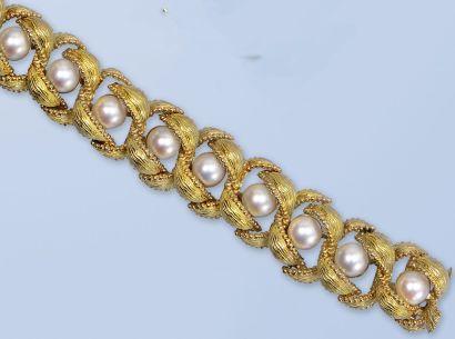 Bracelet en or jaune 18K, 750 millièmes....