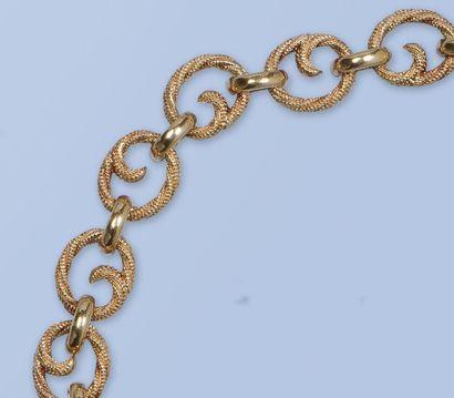 Bracelet en or jaune 18 K, 750 millièmes....