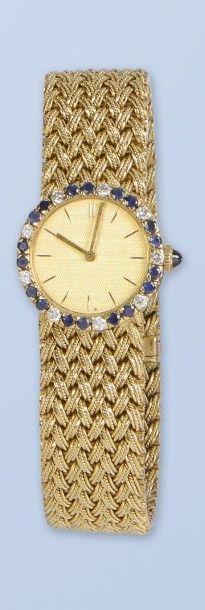 Bracelet montre en or jaune 18 K, 750 millièmes, pour femme, de Marque BOUCHERON....