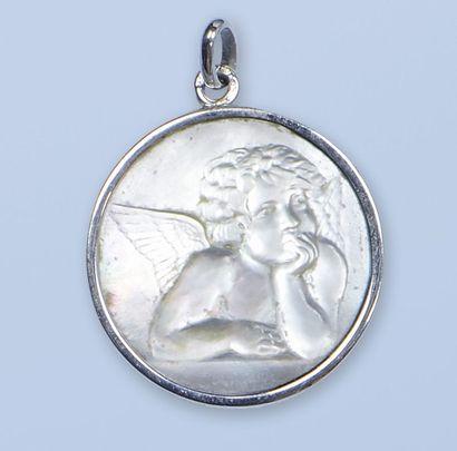 Médaille en or gris 18 K, 750 millièmes....