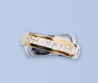 Belle bague en or gris et or jaune 750 millièmes,...