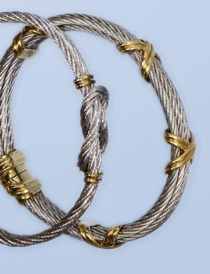 Bracelet en acier et or 750 millièmes, signé...