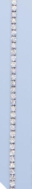 Bracelet souple en or gris 18 K, (750 millièmes)....