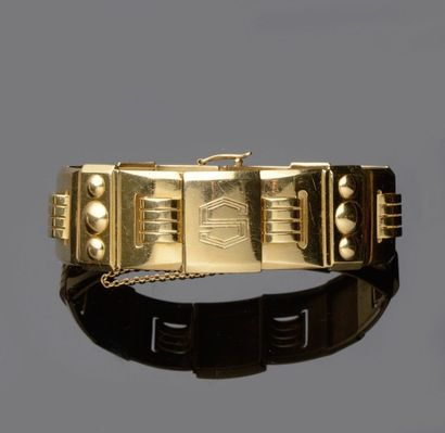 Large bracelet en or jaune à décor géométrique...