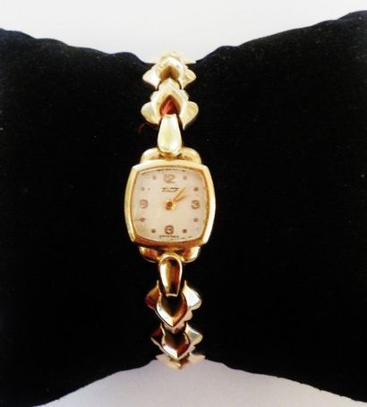 TISSOT  Une montre de dame, cadran rond,...
