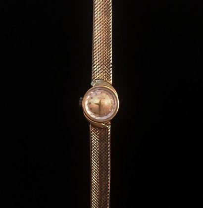 Montre de dame bracelet en or jaune 18 K...