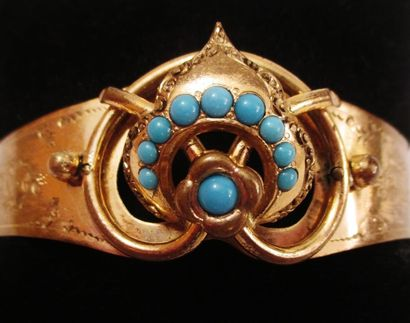 Bracelet fantaisie en métal doré à motif...