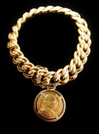 Bracelet gourmette en or jaune 18 K (750°/°°°)...