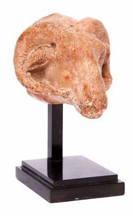 TÊTE DE BÉLIER AN EGYPTIAN LIMESTONE HEAD...